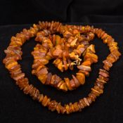 Two uncut and unpolished amber bead neck