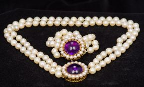 A two strand pearl bead necklace With amethyst set 750 gold clasp;
