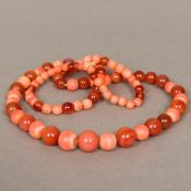 A coral and cornelian bead necklace