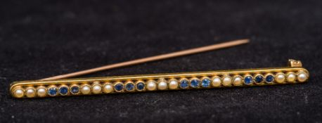 A 15 ct gold sapphire and seed pearl set
