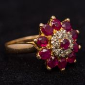 An 18 ct gold diamond and ruby ring