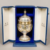 A silver cased limited edition Royal Commemorative urn clock by Mappin & Webb,