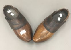 A pair of 19th century leather clad clogs