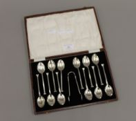 A cased set of silver teaspoons and tongs, hallmarked for Birmingham 1926,