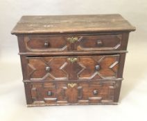 A 17th century oak geometrically moulded chest of drawers. 109 x 57 x 87.5 cm high.