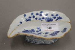 A Chinese porcelain blue and white leaf dish.