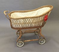 A vintage wicker pushchair/cot