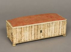 A 19th century stag antler clad box, of hinged rectangular form, with upholstered pin cushion lid,