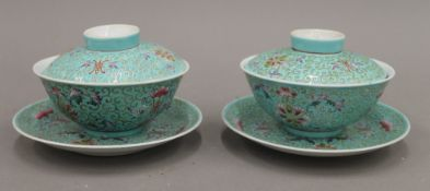 A pair of Chinese porcelain covered bowls and saucers