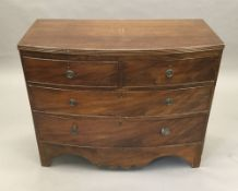 A Victorian mahogany bow front chest of drawers, with two short drawers over two long drawers.