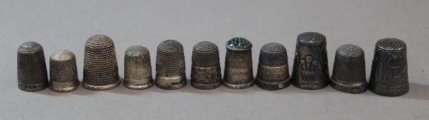 Eleven various silver thimbles, various dates and makers.