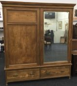 A Victorian ash two door wardrobe, one mirrored. 191 x 58 cm, 210 cm high.