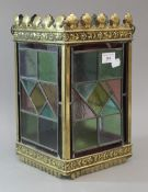 A Victorian brass framed stained lead glazed hall lantern