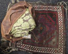 A Caucasian saddle bag rug,