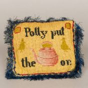 A vintage Folk Art stitched/embroidered cushion bearing the phrase Polly Put the Kettle On,