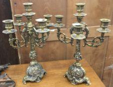 A pair of brass candelabras