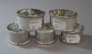 Five various silver napkin rings, various dates and makers (4.