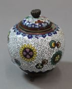 A small cloisonne vase and cover