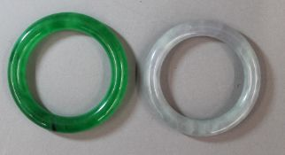 Two Chinese carved jade bangles. 8 and 8.