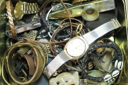 A tin of miscellaneous jewellery, watches, etc.