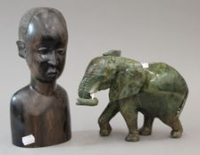 An African ebony carved male bust and a hardstone carved elephant