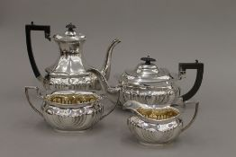 A silver four piece tea set (52 troy ounces total weight)