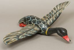 A Folk Art carved and polychrome decorated duck decoy, modelled in flight. 62 cm wingspan.