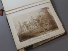 A 19th century scrapbook filled with various sketches and watercolours,