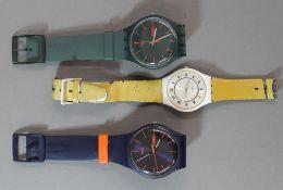 Three vintage Swatch watches