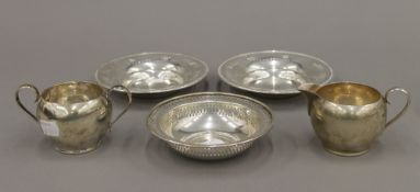 A pair of American sterling silver monogrammed bon bon dishes with pierced borders by Gorham,