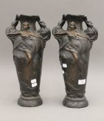 A pair of faux bronze plaster vases