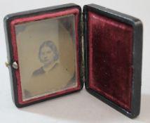 A daguerreotype type photograph in folding case