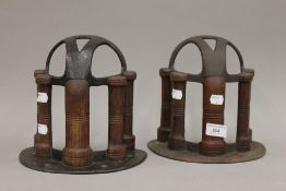 A pair of antique cast iron mahogany mounted harness/tack racks,