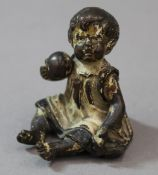 A small cold painted bronze figure of a young girl