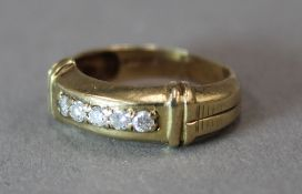 A 9 ct gold five stone diamond ring (3.