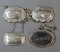 A silver decanter label and three plated decanter labels