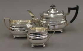 A silver three piece tea set (37 troy ounces total weight)