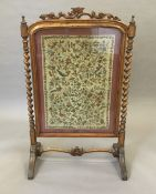 A Victorian tapestry inset fire screen