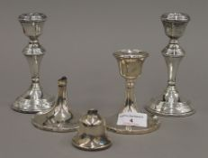 Two pairs of silver candlesticks (20.