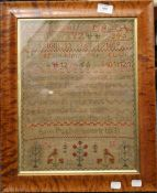 An early 19th century framed sampler,