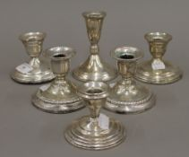 Two pairs of loaded American sterling silver dwarf candlesticks,