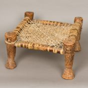 An African tribal stool, the lattice worked seat animal hide. 21.5 cm high.
