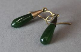 A pair of 1930s rose gold and jade earrings