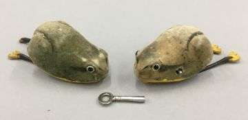 A pair of Schuco clockwork frogs
