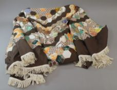 A vintage patchwork table cover,