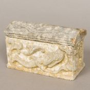 A carved and reconstituted stone model of a sarcophagus,