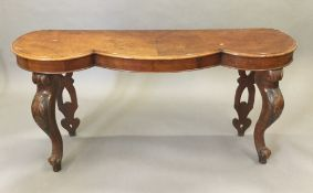 A Victorian walnut hall table with shaped top and cabriole legs. 157 x 44 cm, 73.5 cm high.