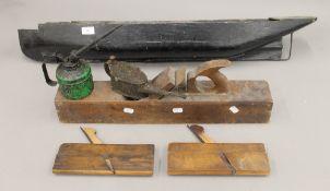 A vintage saw, planes,