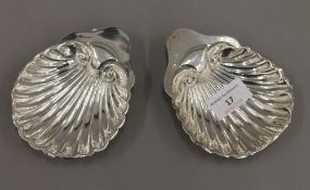 A pair of silver butter shells (3.