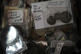 A tin of coins,